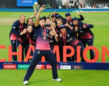England's Katherine Brunt takes a selfie as England players celebrate with the trophy after winning the ICC Women's World Cup 2017 final match against India at Lord's in London, England, Sunday, July 23, 2017. (AP Photo/Rui Vieira)