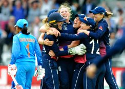 England's Anya Shrubsole, centre, celebrates with teammates as England win the ICC Women's World Cup 2017 final match against India at Lord's in London, England, Sunday, July 23, 2017. (AP Photo/Rui Vieira)