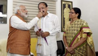 New Delh: Prime Minister Narendra Modi offers sweets to Vice President elect Venkaiah Naidu at his residence in New Delhi on Saturday. PTI Photo by Vjay Verma (PTI8_5_2017_000155B)