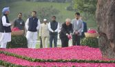 New Delhi: Former President Pranab Mukherjee with former Prime Minister Manmohan Singh and Congress vice-president Rahul Gandhi paying homage to Indira Gandhi on her 100th birth anniversaryt at Shakti Sthal in New Delhi on Sunday. PTI Photo (PTI11_19_2017_000017B)